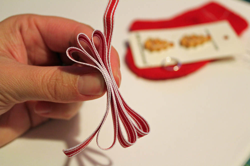 fold ribbon to make bow for mitten ornament