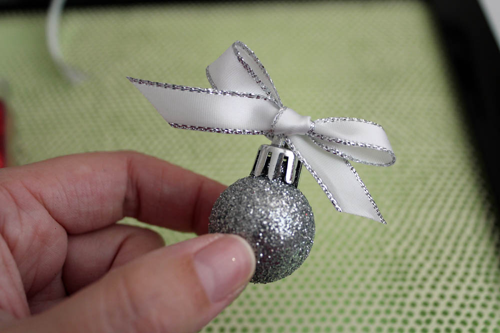 tie a bow on the ornament