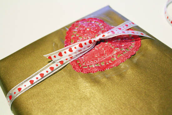 add ribbon to valentine's gift wrap