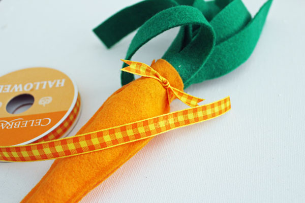 add ribbon to top of carrot