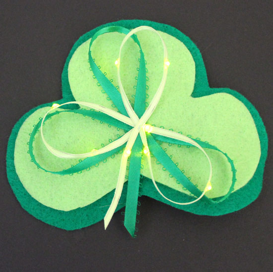 light up shamrock pin