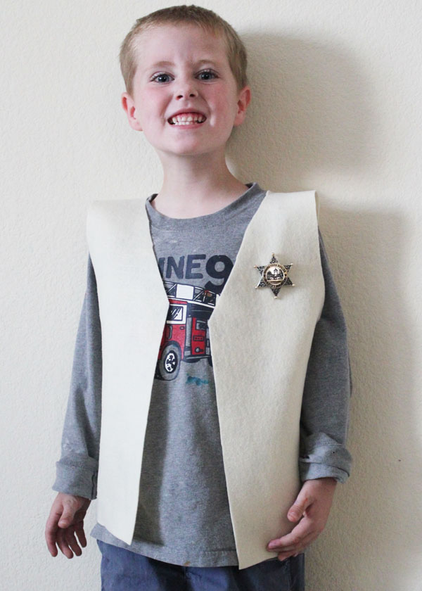 cowboy vest and a cheezy smile