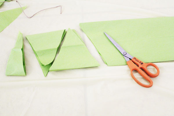 fold paper in fourths and cut