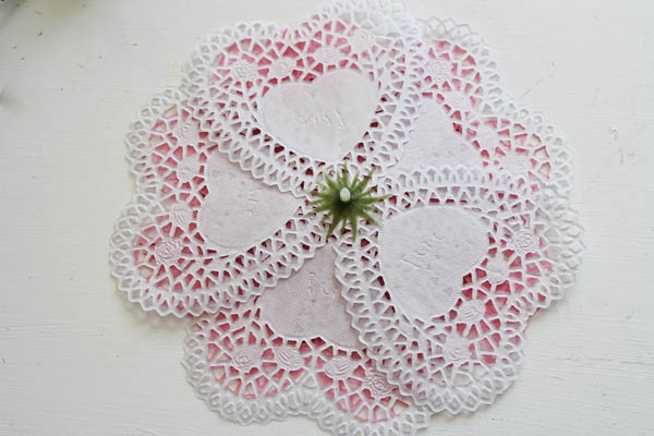 put the white doilies and green stem back on