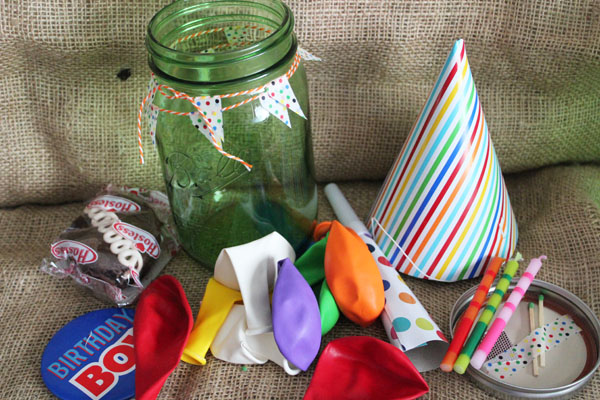 birthday party supplies tucked into a mason jar