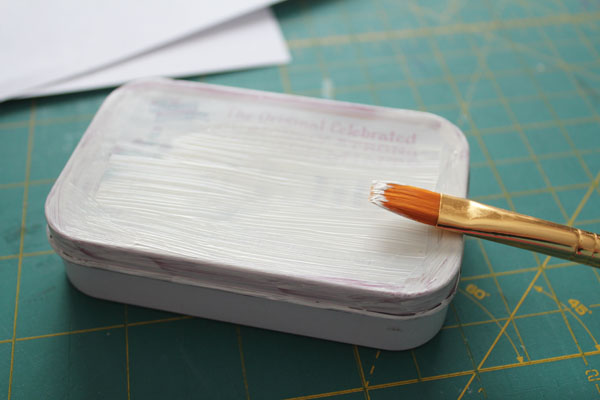 paint altoids tin with two coats of white