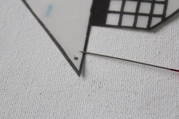 make holes with a pin
