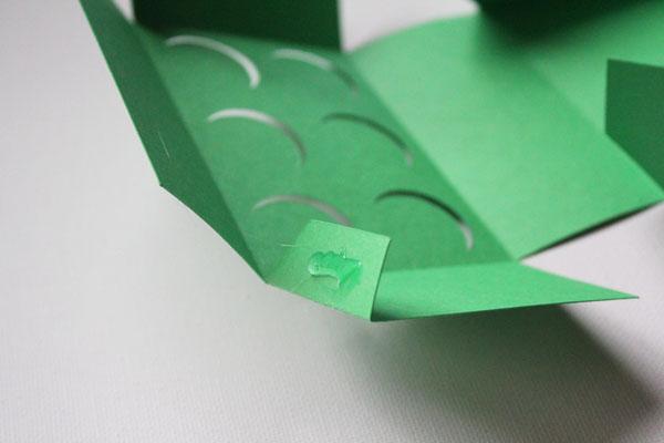 add hot glue to flaps