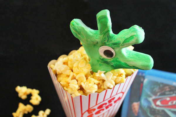 creepy hand in the popcorn