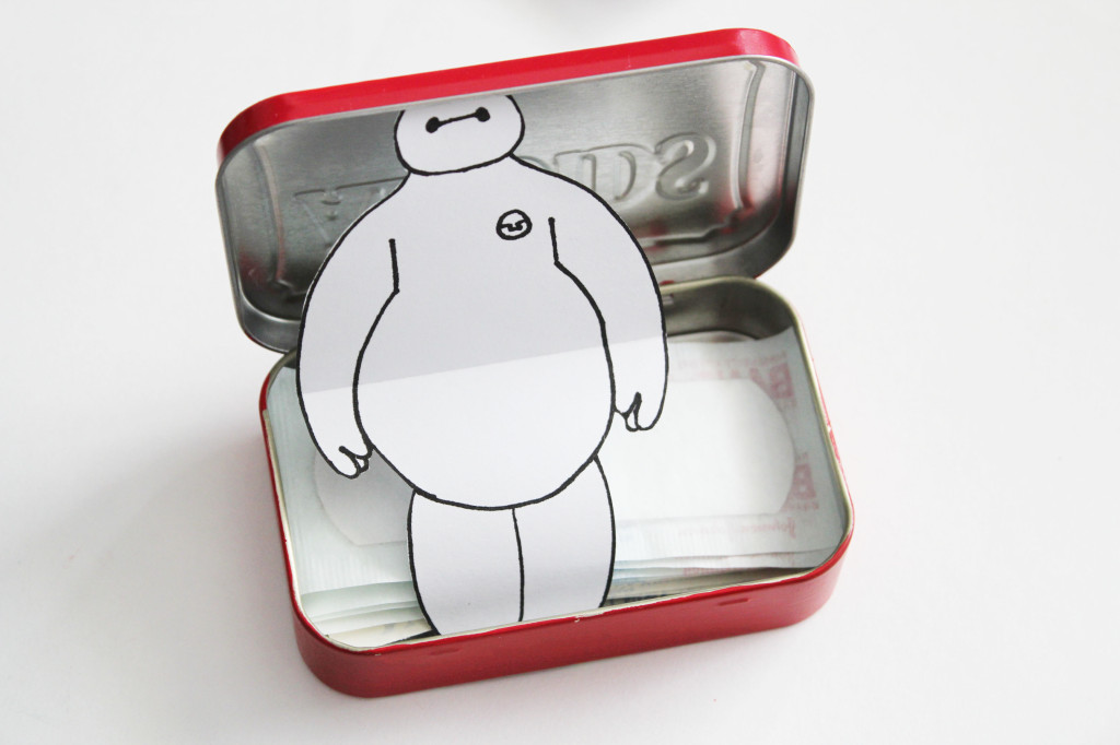 baymax in a bandaid tin image