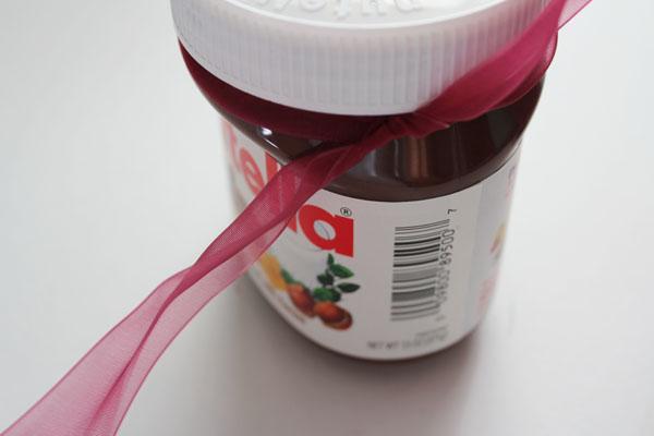 tie ribbon on top of nutella jar