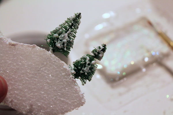 add glitter and mod podge to trees
