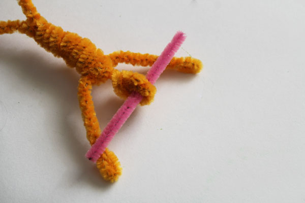 insert cut of pink pipe cleaner