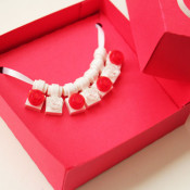 put necklace in box