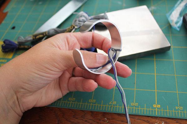 tie floss at back of bangle