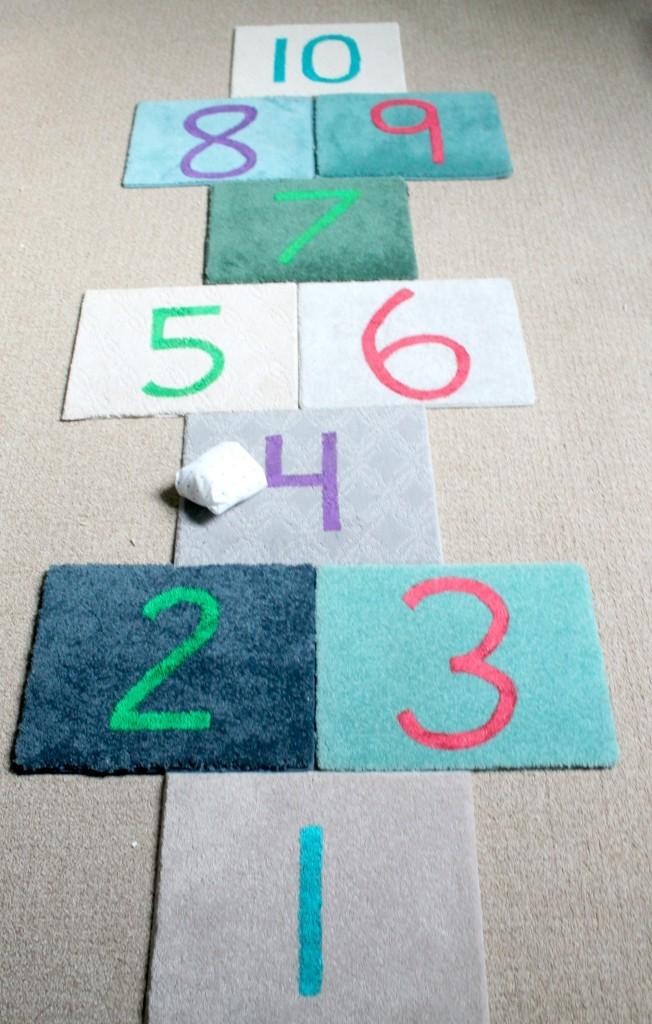 hopscotch-squares-with-carpet-tiles-and-a-beanbag-652x1024