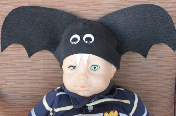 creepy doll wearing bat hat