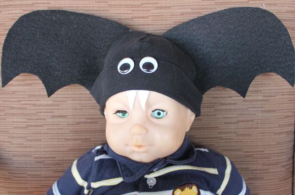 creepy doll wearing bat hat