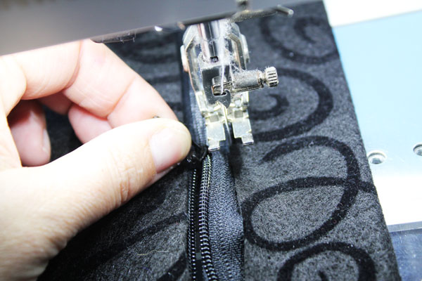 to move the zipper lift the presser foot