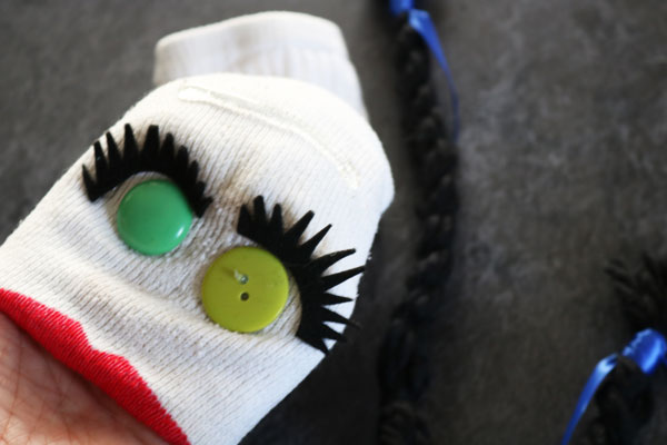 glue hair on sock puppet